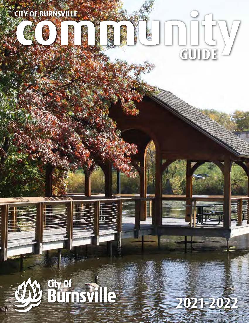 A mother and son sit on a rock next to the Minnesota River on the cover of the 2019 Community Guide